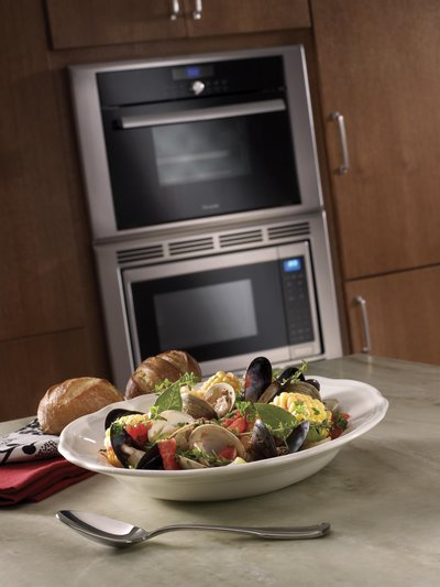 A beauty shot from Thermador showing the steam oven's flexible install and some amazing shellfish.